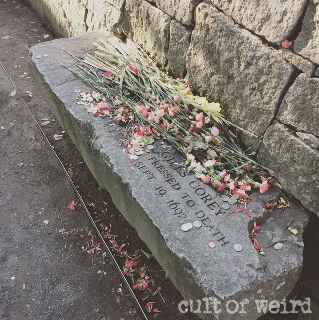 The memorial of Giles Corey at the Salem Witch Trials Memorial