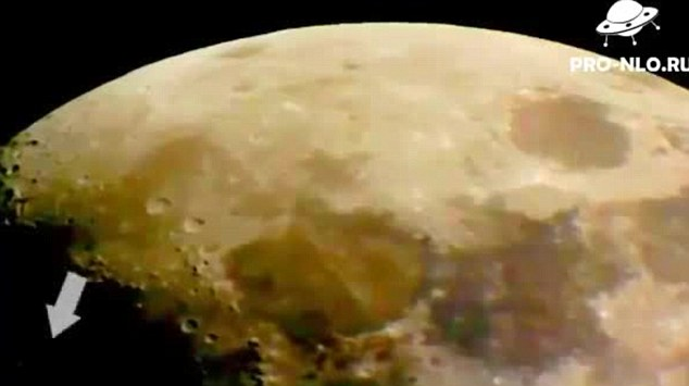 An encounter on the dark side of the moon 'UFO' spotted soaring above lunar surface in online video