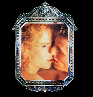Promotional images for the movies feature Alice kissing Bill but looking at herself in the mirror, almost as if she was living in an alternate reality.