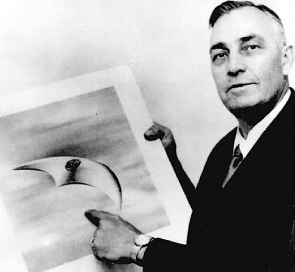 Pilot Kenneth Arnold with an illustration of a UFO he saw in 1947. The modern run of UFO sightings began when Arnold reported seeing nine objects flying in a V-formation over Mt. Ranier in Washington. Click for more on the story.