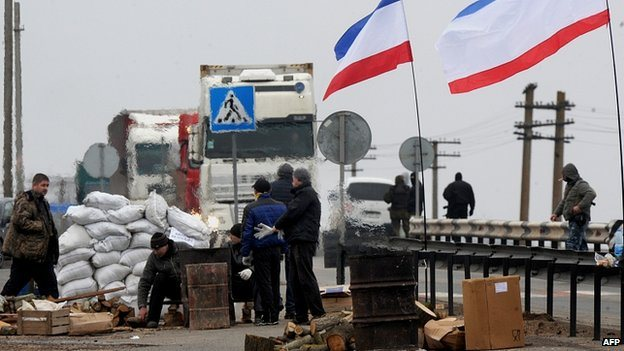 "Men calling themselves ""local militia"" at a checkpoint  the city of Armyansk"