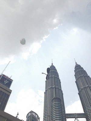 Rare Double Eyewitness Capture of UFO Over Petronas Towers  93