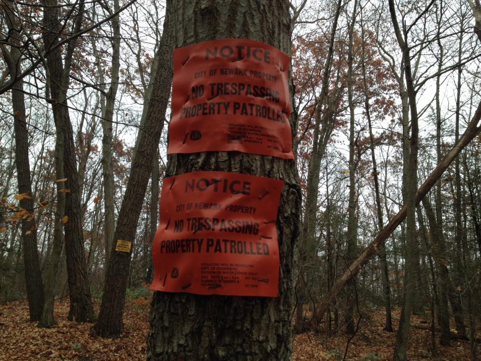 Signs let any amateur ghost hunters know that wandering into the woods without a permit is not tolerate along Clinton Road.