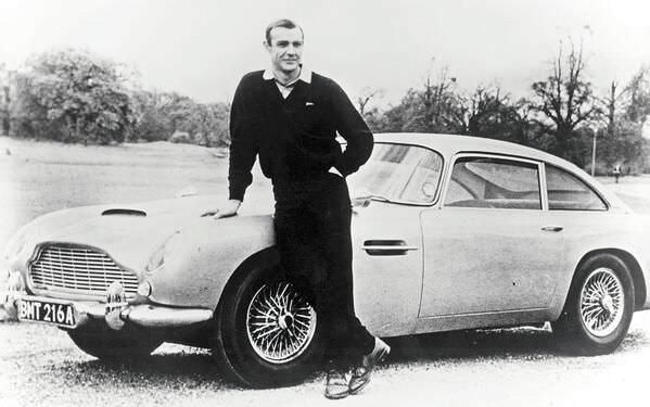 Sean Connery as James Bond, poses with Aston Martin DB5 - 1965