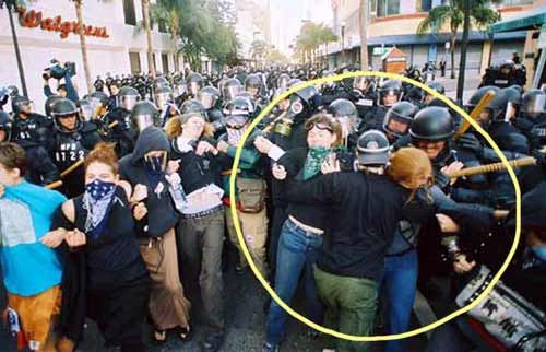 Agent Provocateurs are undercover police that deliberately turn peaceful protests into violent protests so police have an excuse to break it up.