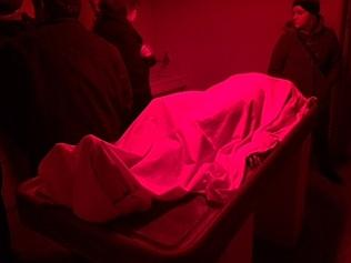 A creepy mannequin posed as a corpse in the station's very dark morgue.