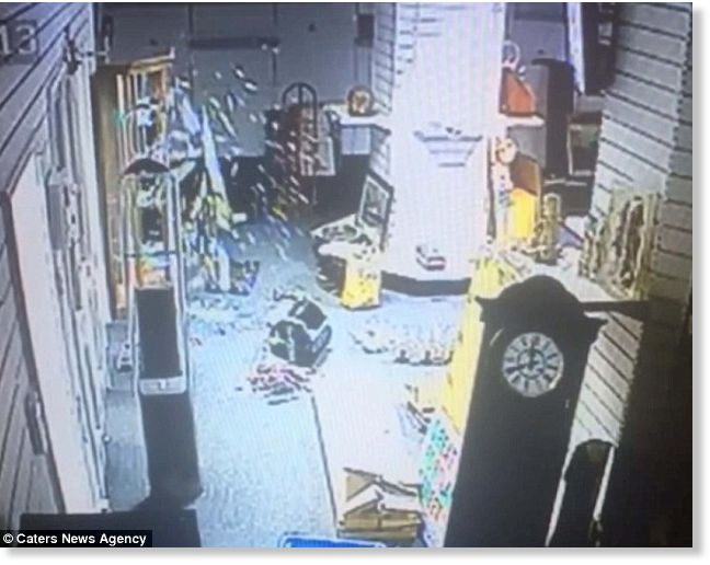 Caught on video: Spooky moment glass cabinet opens by itself and shatters into pieces in locked, empty room 1