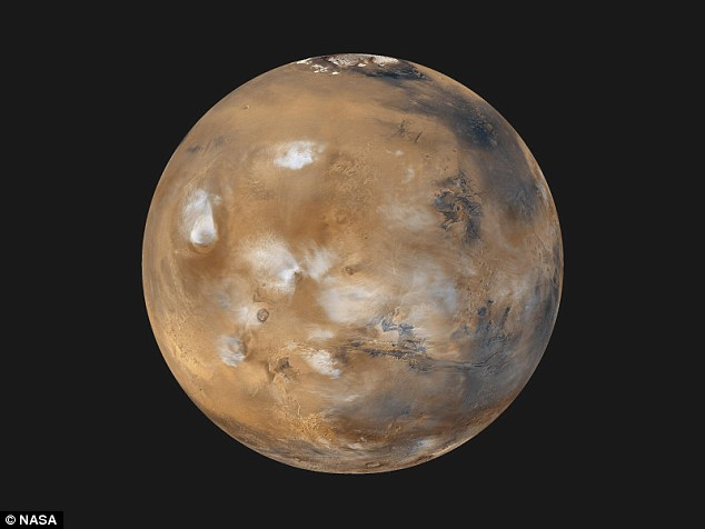 Back in 2011 the scientist first postulated that the red colour on Mars (pictured) could have been due to a naturally occurring thermonuclear explosion - but now he thinks it was caused by an intelligent alien race