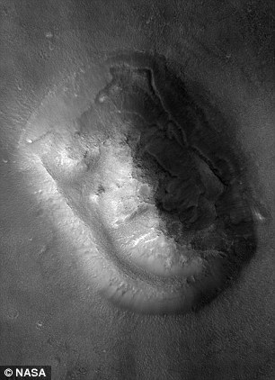 Later images showed the 'face on Mars' was just a chance alignment of shifting dust dunes (pictured)
