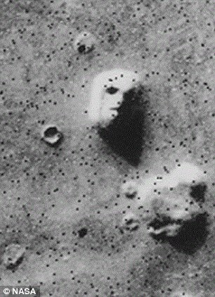 Dr Brandenburg says evidence for the explosions exists near two sites that apparently had life in the past, including Cydonia, the location of the famous 'face on Mars' spotted from orbit (shown)