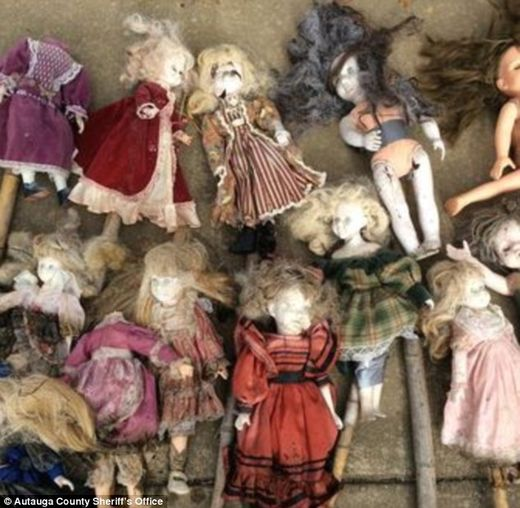 Twenty-one porcelain dolls on bamboo stakes found in Alabama swamp, some missing heads  95