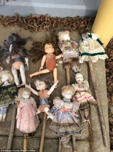 Twenty-one porcelain dolls on bamboo stakes found in Alabama swamp, some missing heads  94