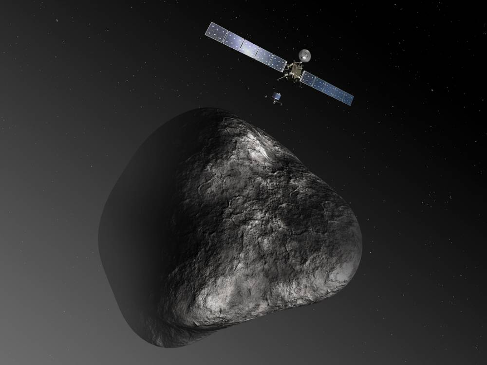 An artist's impression handout image by the European Space Agency shows the Rosetta orbiter deploying the Philae lander to comet 67P/ChuryumovñGerasimenko. After a 10-year journey, the Rosetta spacecraft is due to end its hibernation on January 20, 2014 and prepare for an unprecedented mission to orbit the comet and dispatch a lander to the surface. The image is not to scale; the Rosetta spacecraft measures 32 m across including the solar arrays, while the comet nucleus is thought to be about 4 km wide. REUTERS/European Space Agency-C. Carreau/ATG medialab/Handout via Reuters (OUTER SPACE - Tags: SCIENCE TECHNOLOGY)      ATTENTION EDITORS - THIS IMAGE WAS PROVIDED BY A THIRD PARTY. FOR  EDITORIAL USE ONLY. NOT FOR SALE FOR MARKETING OR ADVERTISING CAMPAIGNS. NO SALES. NO ARCHIVES. THIS PICTURE IS DISTRIBUTED EXACTLY AS RECEIVED BY REUTERS, AS A SERVICE TO CLIENTS