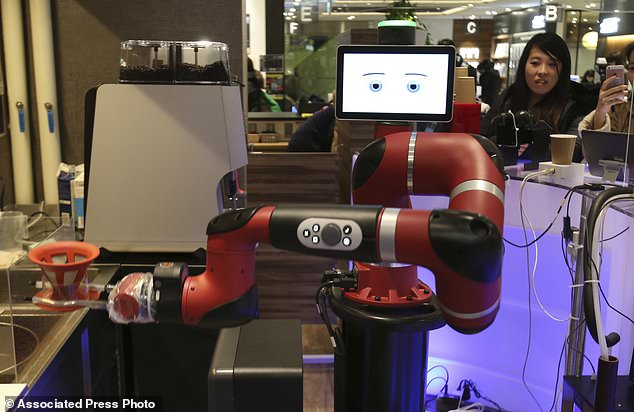 One-armed barista robot begins serving coffee at new cafe in Japan's capital 11