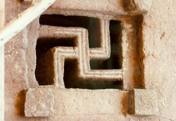 Swastika symbol carved on the window of Lalibela Rock hewn churches, Ethiopia.