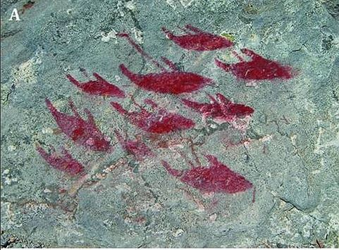 Scientists discover ancient rock art with paintings of whales and sharks in the desert 95
