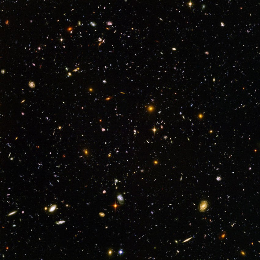 But let's think bigger. In JUST this picture taken by the Hubble telescope, there are thousands and thousands of galaxies, each containing millions of stars, each with their own planets.