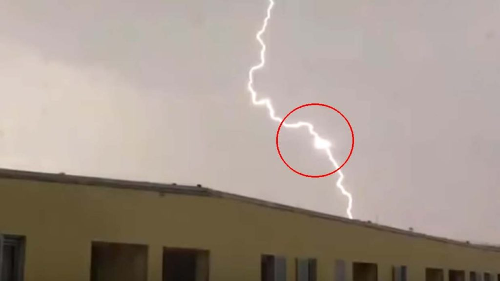 Photograph of a triangular UFO feeding the energy of lightning in the Czech Republic 1