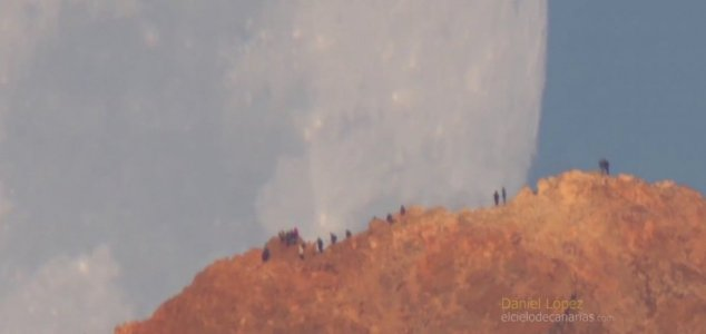 New video shows Moon setting behind volcano 1