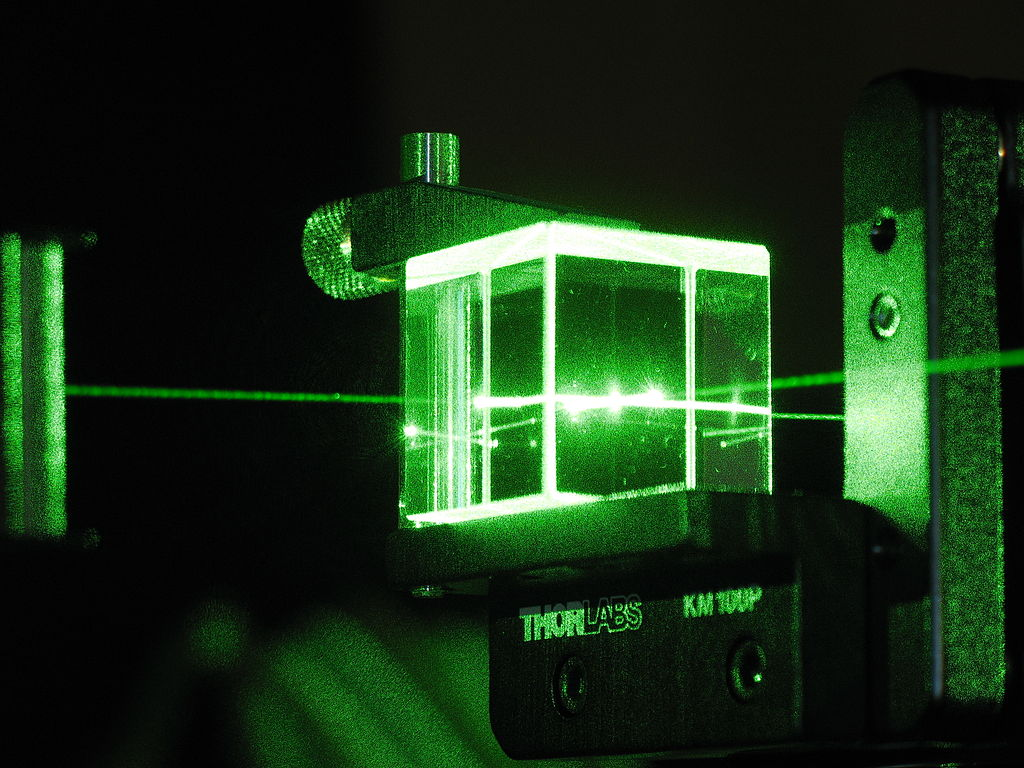 A laser experiment. By melissa.meister from Atlanta, USA (Beam splitter - Thorlabs logo) [CC BY-SA 2.0], via Wikimedia Commons