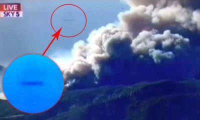 A cigar-shaped UFO bursts into the news broadcast on wildfires in California 89