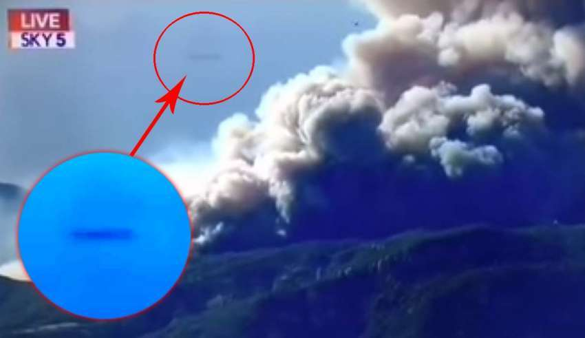 A cigar-shaped UFO bursts into the news broadcast on wildfires in California 86