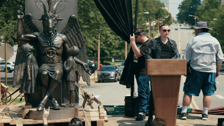 Satanic Temple co-founder Lucien Greaves delivers a speech in front of the Arkansas Capitol, with the group's Baphomet statue