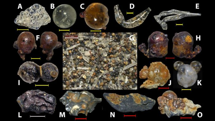 This assortment of glassy particles was discovered in beach sands near Hiroshima. (c) Anthropocene, Volume 25, March 2019