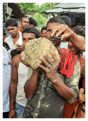 © STR/AFP/Getty Images A villager holds the suspected meteorite.