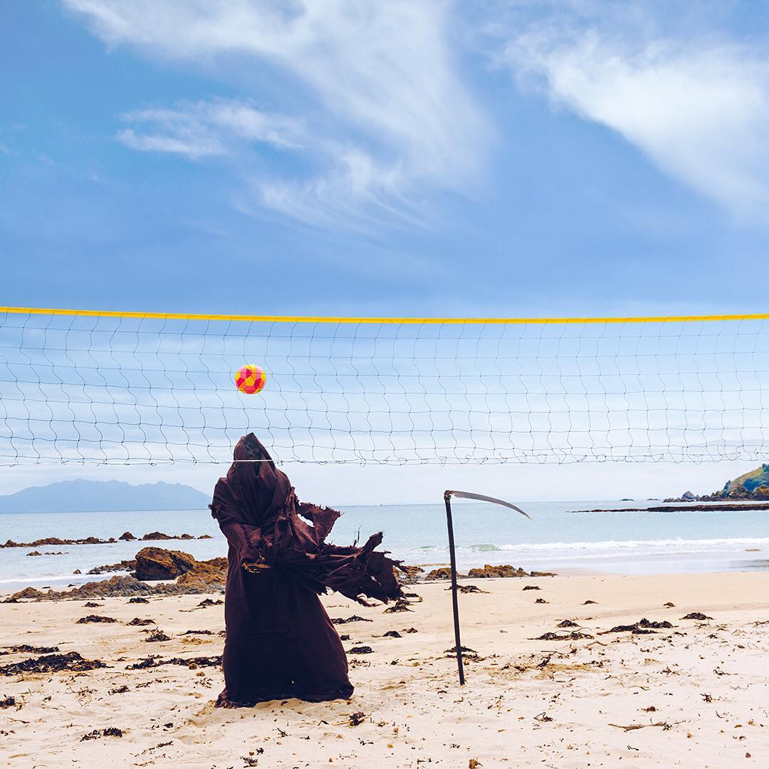 Beach volleyball with the Grim Reaper
