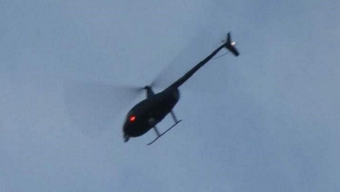 Ufologist Nick Redfern shoots famous black helicopters over his home 96