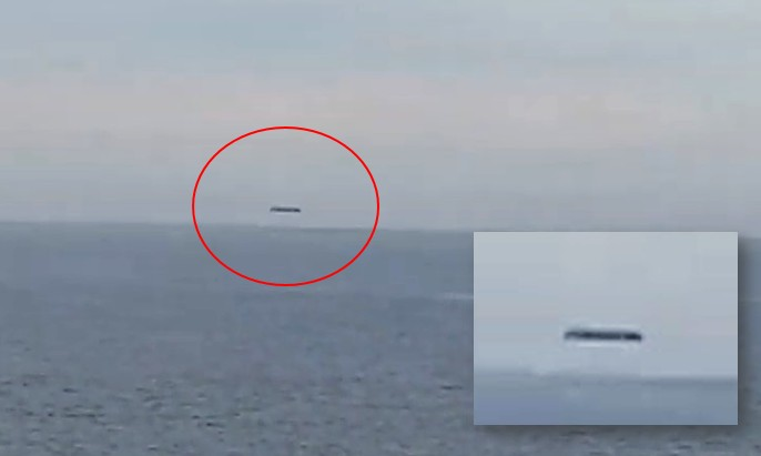 A huge cylindrical UFO is filmed over the Welsh sea 92