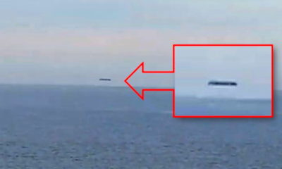 A huge cylindrical UFO is filmed over the Welsh sea 87