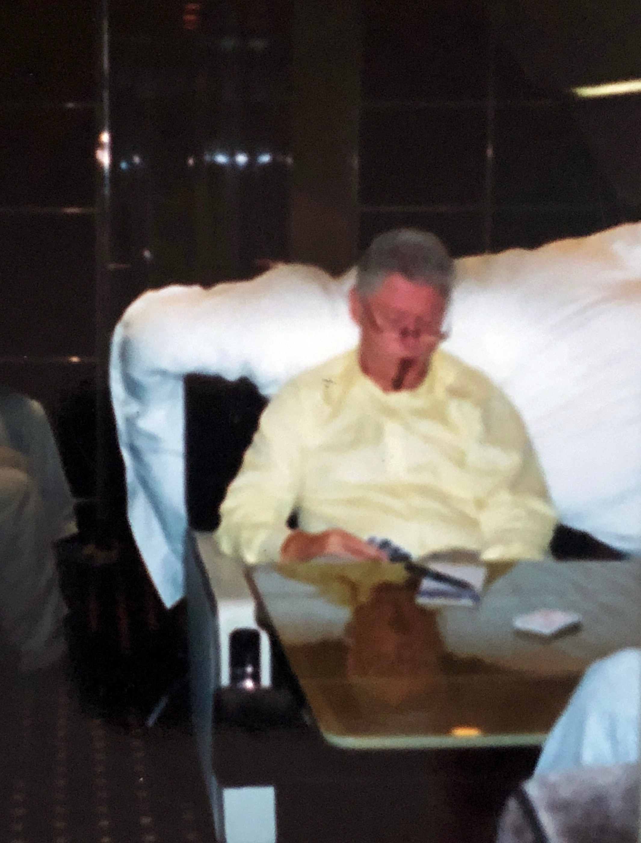 Bill Clinton chomps on a cigar on board Epstein's luxurious private jet