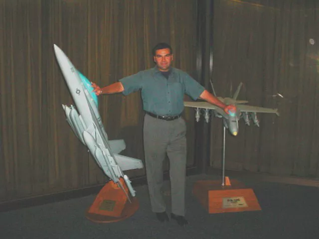 The alleged image of Salvatore Pais, standing among the large Super Hornet and Growler models.