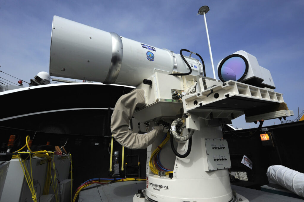 US shows laser weapon test against drones 13