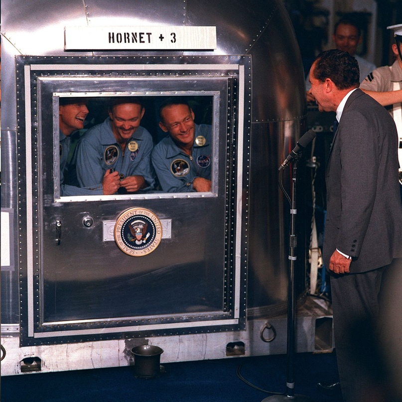 Apollo 11 crew greets President from quarantine van