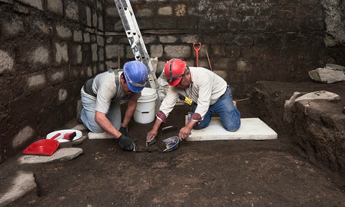 While renovating a historic building, workers stumbled upon unusual basalt slabs.