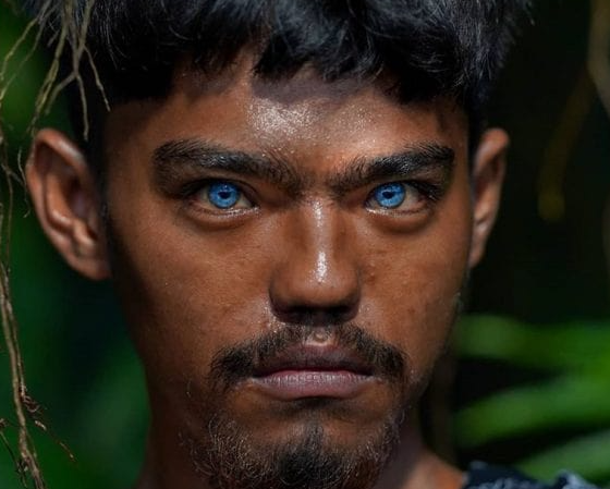 Inhabitants of Buton Island have abnormal blue eyes. The source of the glow makes them new mutants 87