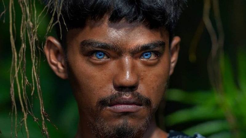 Inhabitants of Buton Island have abnormal blue eyes. The source of the glow makes them new mutants 39