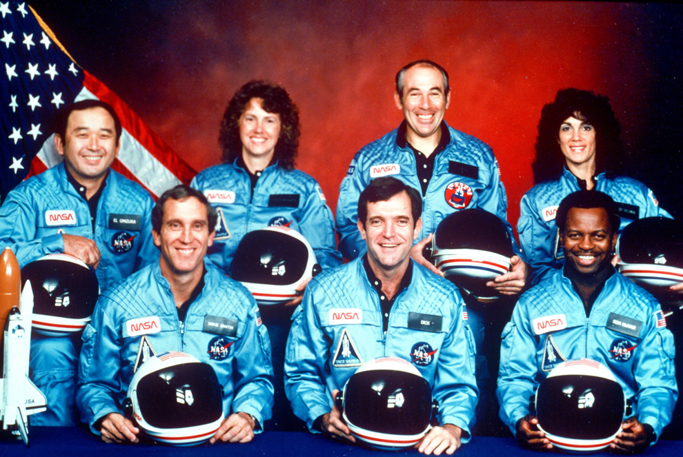 The crew of the Challenger spacecraft.  From left to right: Allison Onizuka, Mike Smith, Christa McAuliffe, Dick Scobie, Greg Jarvis, Ron McNair and Judith Resnick.  (NASA / 1986)