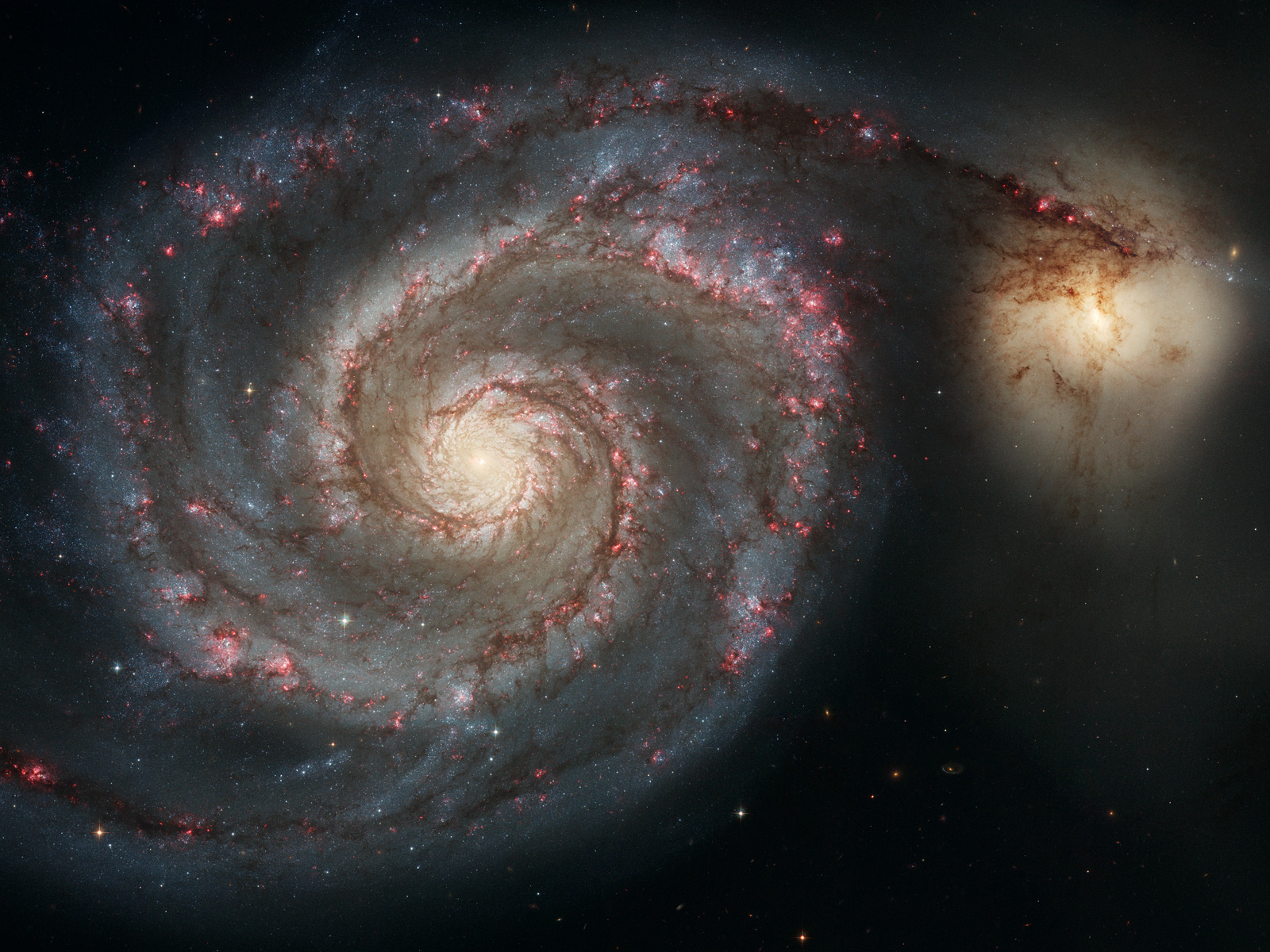 Whirlpool Galaxy M51 and companion by Hubble