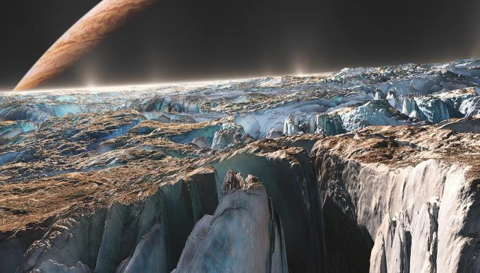 NASA: The surface of Europa glows blue and green at night 23