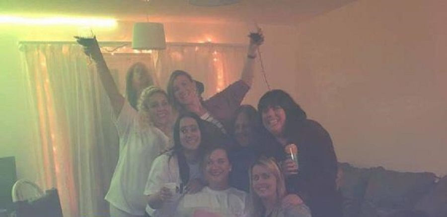 Friends posed for a bachelorette party photo, not suspecting that a screaming ghost was hiding behind their backs 1